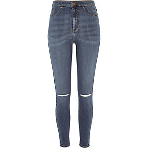 Mid blue wash high rise going out jeggings