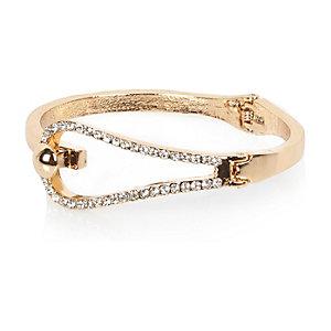 Gold tone diamanté loop bangle