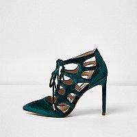 Chaussures en velours bleu à découpes