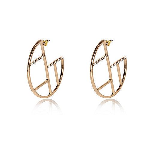 Gold tone grid hoop earrings