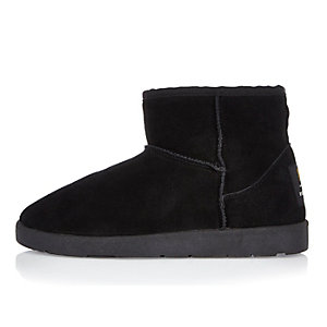 Black faux fur lined low ankle boots