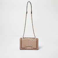 Light pink patent quilted handbag