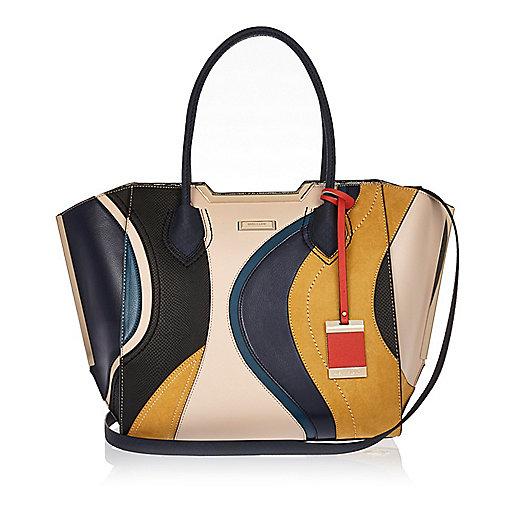 Navy swirl winged tote handbag