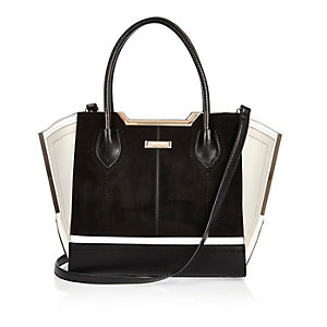 Black and white suede winged tote handbag
