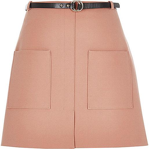 Mini-jupe rose clair avec poche et ceinture
