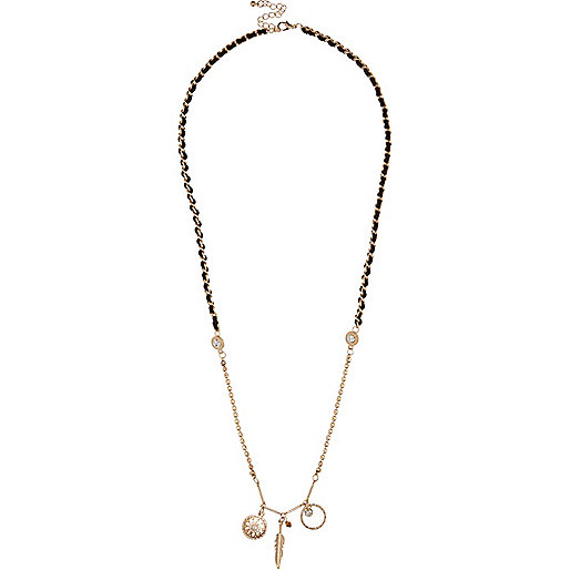Gold tone charm necklace