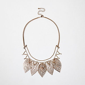 Gold tone filigree leaf bib necklace