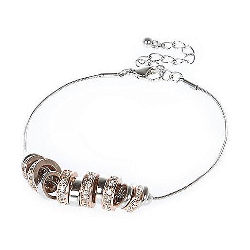Bracelet avec anneaux doré rose