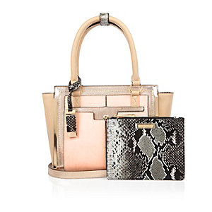 Pink winged tote handbag with purse