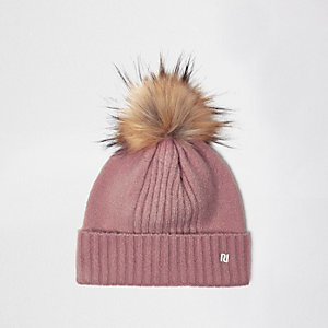 Light pink pom pom beanie