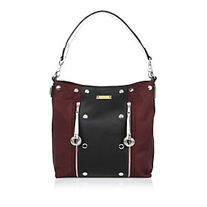 Red studded slouchy handbag