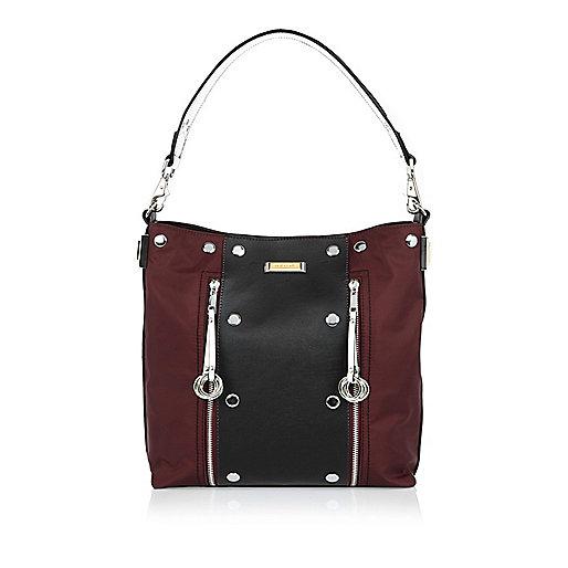 Red studded slouchy handbag