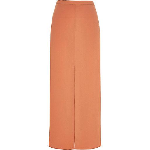 Jupe longue orange clair fendue sur le devant