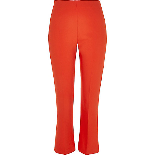Red flared cropped trousers