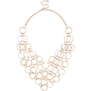 Gold tone multi ring bib necklace
