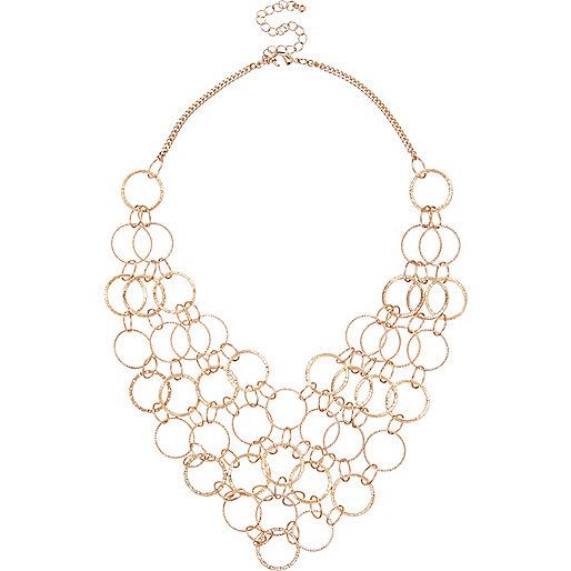 Gold tone multi ring bib necklace