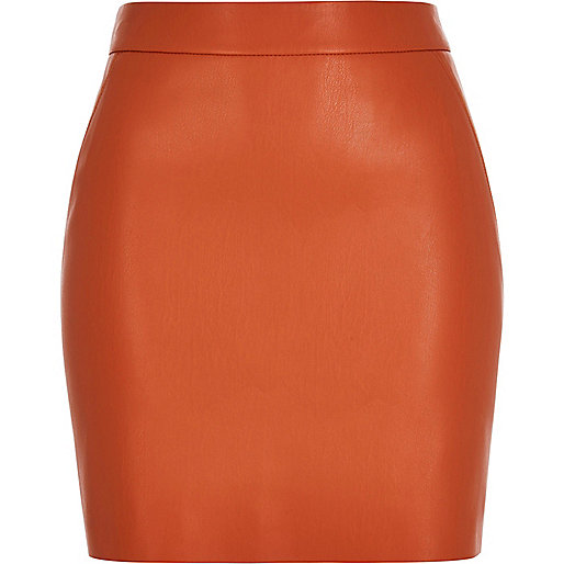 Orange leather look mini skirt