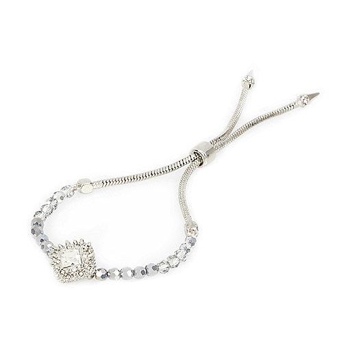 Bracelet argenté avec breloque en strass