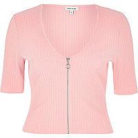 Light pink zip front crop top