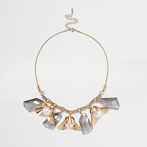Gold tone flower detail statement necklace