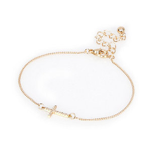 Gold tone diamanté cross bracelet
