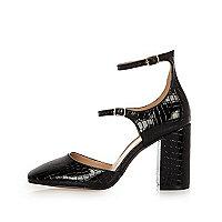 Schwarze Schuhe mit zwei Riemen und Blockabsatz
