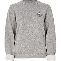 Grey brooch sweatshirt