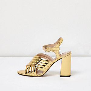 Gold patent cross strap heels