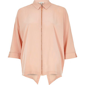 Light pink zip front shirt