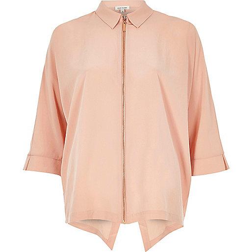 Light pink zip front shirt