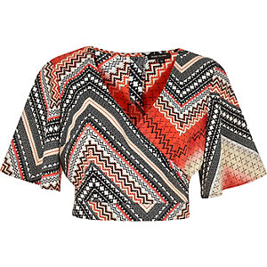 Orange Aztec print wrap crop top