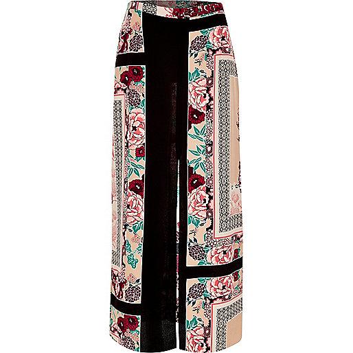 Jupe longue à imprimé oriental rose fendue sur le côté