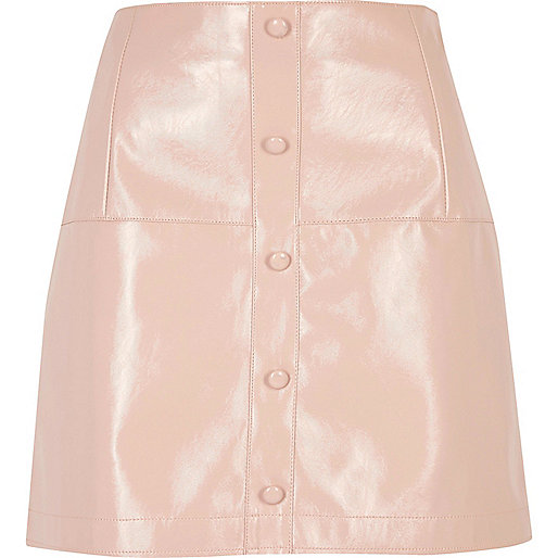 Pink patent buttoned mini skirt