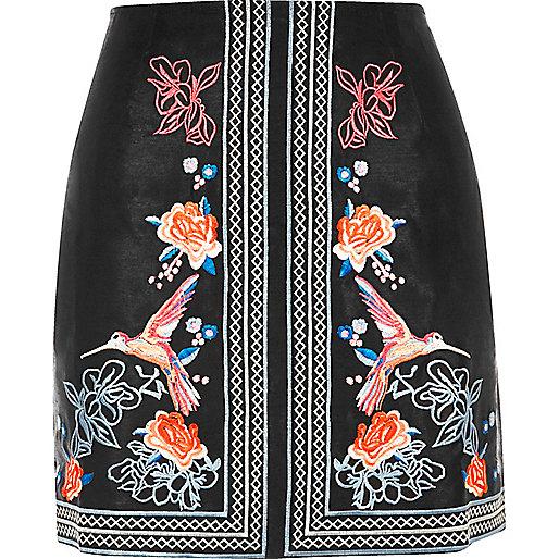 Mini-jupe noire à fleurs brodées