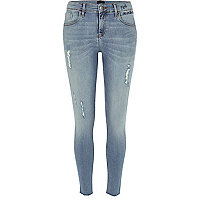 Light blue ripped Amelie super skinny jeans