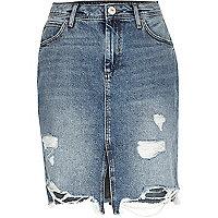 Jupe mi-longue en jean délavage bleu moyen déchirée