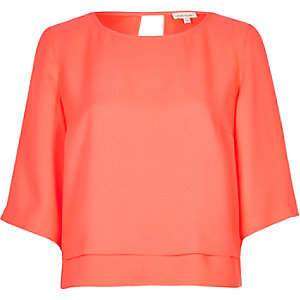 Bright pink cropped top