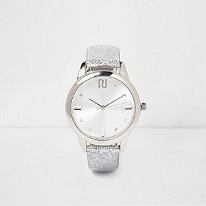 Silberne Armbanduhr mit Schmucksteinen