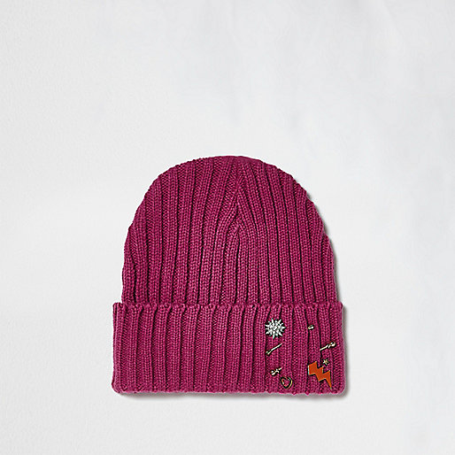 Bright pink knit badge beanie