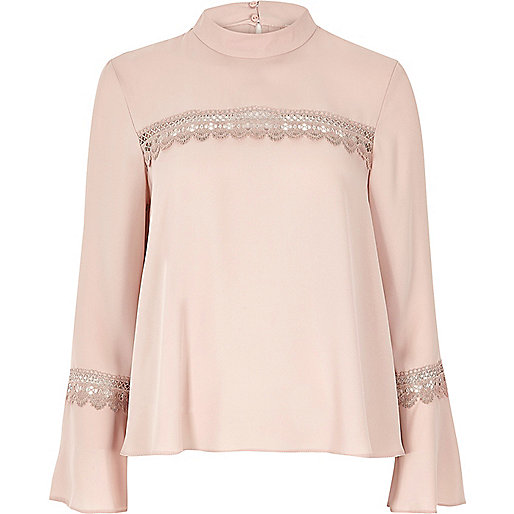 Blush pink bell sleeve top with lace detail