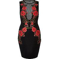Robe moulante en tulle noire motif roses