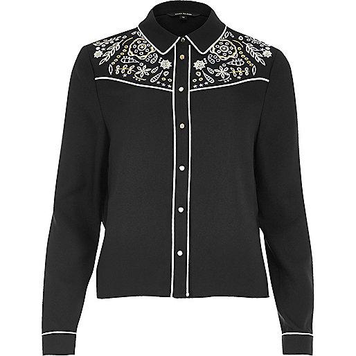 Chemise noire à découpes