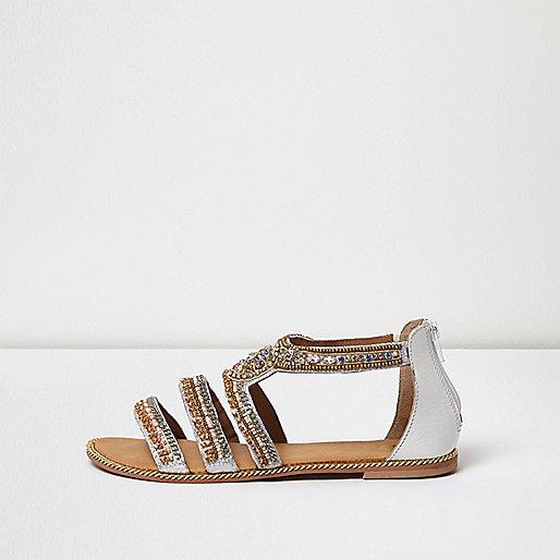 Sandales dorées avec brides multiples ornées