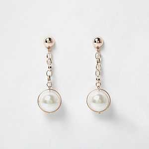 Rose gold tone pearl dangly earrings