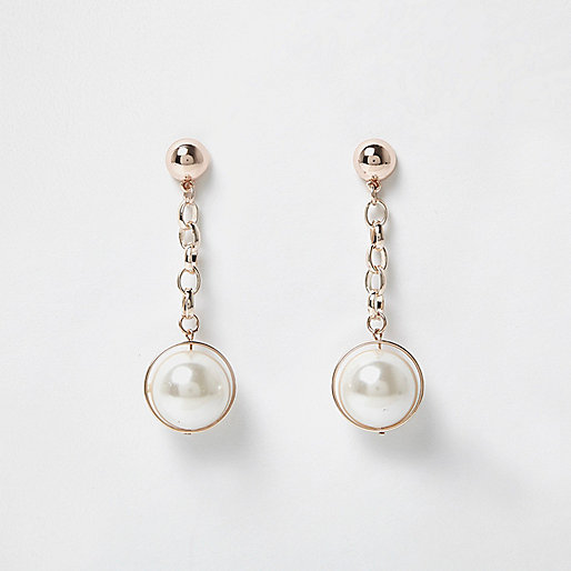 Rose gold tone pearl dangly earrings