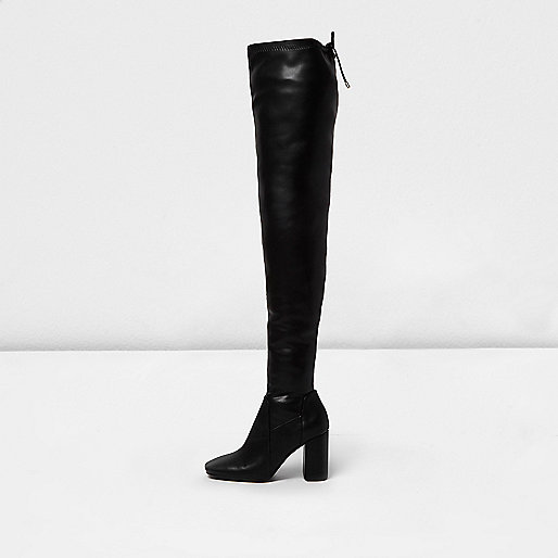 Black leather look flared thigh high boots