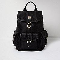 Black oversized flap pocket backpack