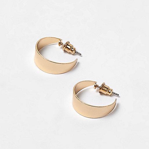 Gold tone thick sleeper hoop earrings