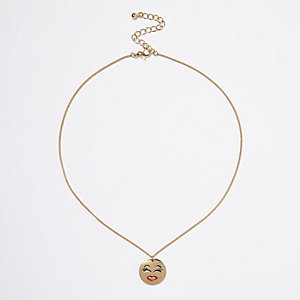 Gold tone smiley face coin necklace