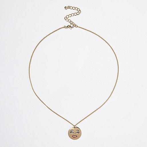 Gold tone smiley face coin necklace